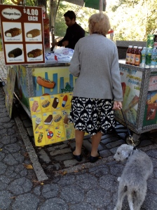 Older woman buying something tasty