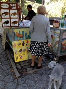 Older woman buying something tasty